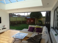 Bi-folds open to reveal an expansive view of the garden