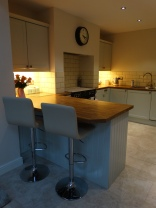 The kitchen, with peninsula breakfast bar