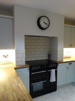 Range oven situated in adapted chimney breast